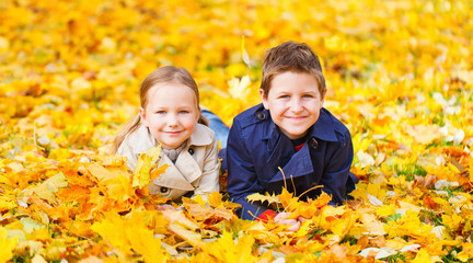 Little kids outdoors in autumn park