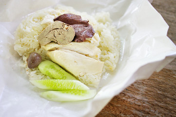 Steamed chicken with rice inside paper package