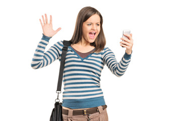 Angry girl looking at a cell phone