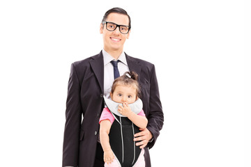 Businessman carrying his baby daughter