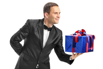Classy guy giving a present to someone