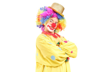 Funny male clown in a yellow costume