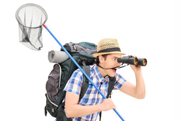 Guy with butterfly net looking through binoculars