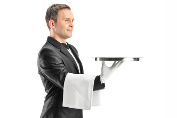 Male waiter serving and holding a tray