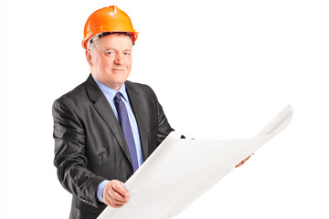 Mature architect looking at a construction plan