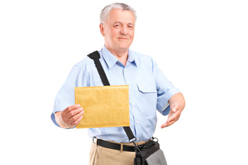 Mature mailman holding an envelope