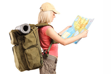 Profile shot of a female tourist looking at a map