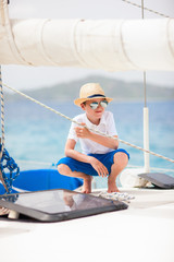 Teenage boy at luxury yacht