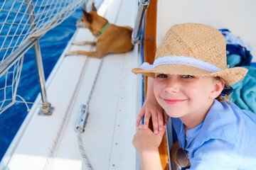 Little girl at luxury yacht with pet dog