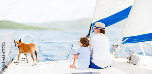 Family sailing on a luxury yacht - 67717142