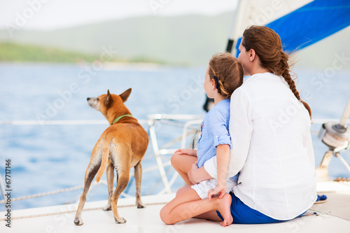 Family sailing on a luxury yacht - 67717146