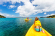 canvas print picture - Family kayaking at tropical ocean