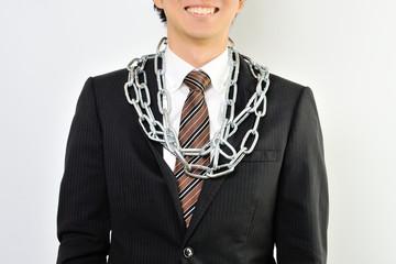鎖で束縛されたサラリーマン