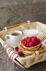 Breakfast of pancakes with raspberries and yogurt