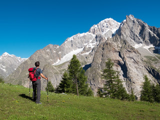 Hiker admiring mountain landscape around Mont Blanc, Courmayer