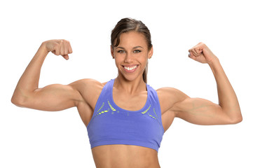 Young Woman Flexing Muscles