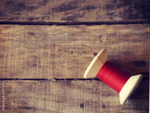 Retro thread rolls on wood background old retro vintage style