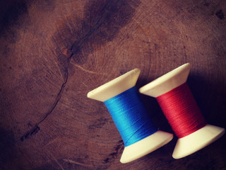 thread rolls on wood background old retro vintage style