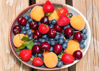 Bowl of summer  fruits and berries.