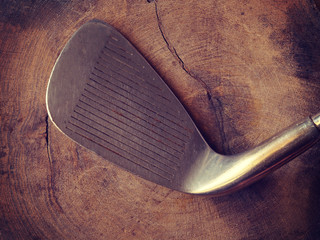 golf clubs on wood background old retro vintage style
