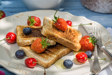 Toast with fruit and honey for breakfast