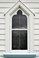 Old wooden church window painted white and blue