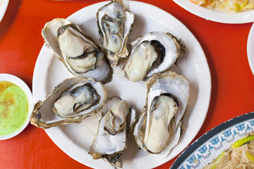 delicious and nutrition sea food  ,barbecue Oysters with mustard