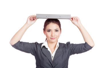 Asian business woman put a folder over her head