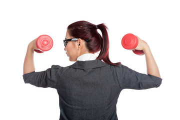 Back of healthy Asian business woman lift dumbbells