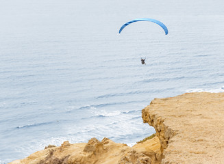 Paragliding over the rocky coast, clifftop view