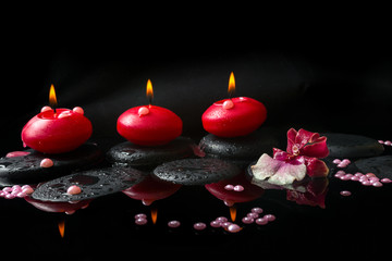 spa concept of white and red orchid (cambria), three  red candle
