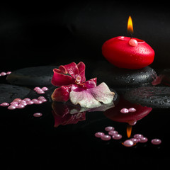 spa concept of white and red orchid (cambria),  red candle and p