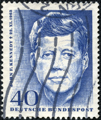 stamp printed in Germany , shows John F. Kennedy