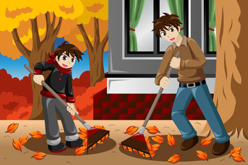 Father son raking leaves during Fall season