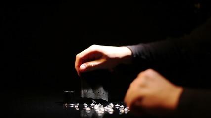 Man considers diamonds through a magnifying glass