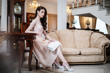 Beautiful young woman in luxury house interior