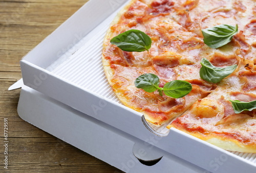canvas print picture traditional Italian pizza with prosciutto ham and basil