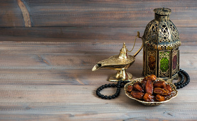 Dates, arabian lantern and rosary. Islamic holiday