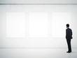 Leinwanddruck Bild - gallery room and man looking at empty frames