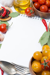 notepad to write recipes, tomatoes and spices