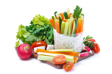 snacks - vegetables with yogurt sauce in a glass and fresh herbs
