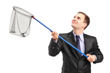 Businessman holding a net