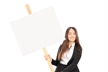 Businesswoman holding a blank signboard