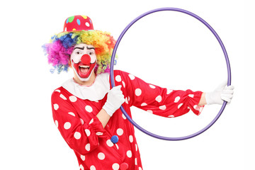 Male clown holding a hula hoop