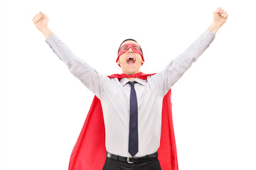 Male superhero raising his hands out of joy