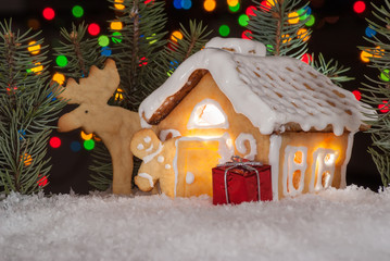 Gingerbread house with gingerbread man, elk and christmas trees