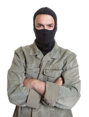 Masked burglar with crossed arms