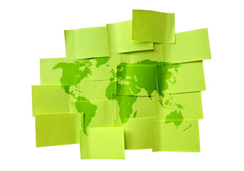 Sticky green memo paper with world map