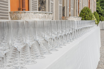 row of empty glasses on a party