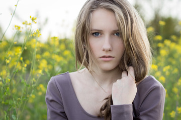 Young beautiful girl outdoor portrait, emotional look